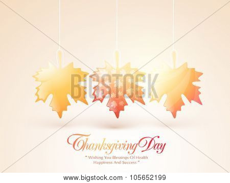Happy Thanksgiving Day celebration with shiny hanging maple leaves on glossy background.
