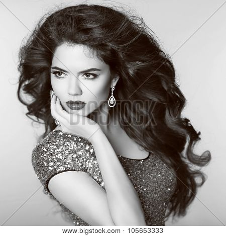 Beautiful Elegant Girl Model With Jewelry, Makeup And Lon Wavy Hair Styling. Black And White Portrai