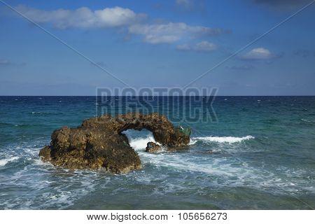 Beautiful rock with an hole at Naxos, Greece near Grotta beach