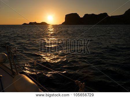 Sunset, Sea And Sailing Boat