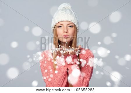 Woman blowing snow at you