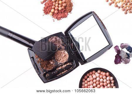 crushed compact eyeshadows with brush isolated on white background