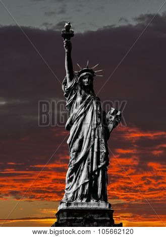 Statue of Liberty New York Manhattan at sunset almost silhouette with black and white Statue of liberty.