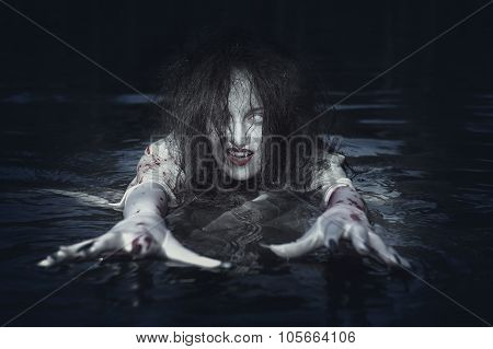 Beautiful Witch Woman Standing In The River