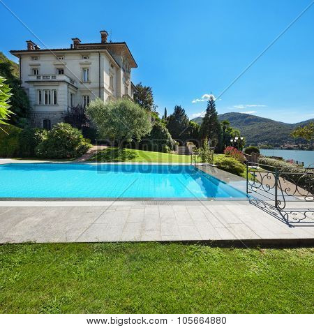 external of a villa, beautiful swimming pool overlooking the lake