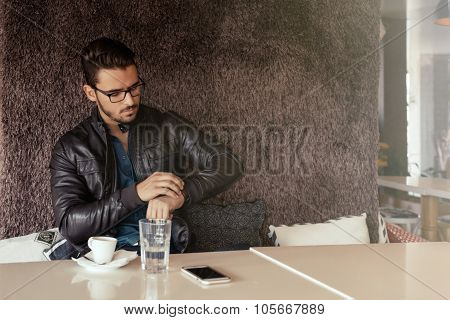 Businessman With Eyeglasses Sitting On Coffee Break