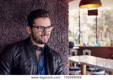Smiling Man With Fashionable Haircut And Eyeglasses