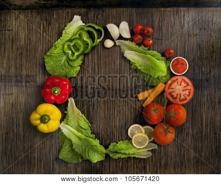 vegetables shaping a circle on wooden background