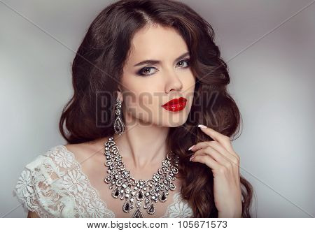Portrait Of A Beautiful Fashion Bride Girl With Sensual Red Lips. Wedding Make Up And Waving Hair. S
