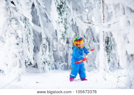 Little Girl Playing With Snow In Winter