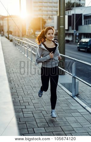 Sporty Woman Jogging In City