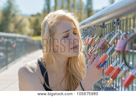 Beautiful Young Blond Woman Holding Padlocks