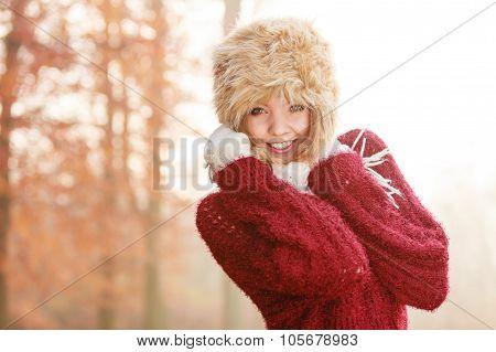 Portrait Of Pretty Smiling Woman In Fur Winter Hat