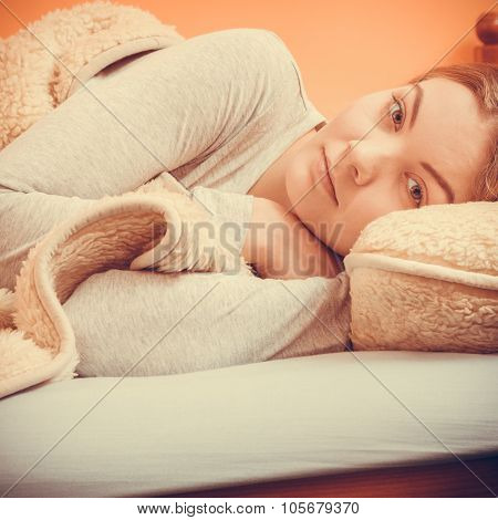 Woman Relaxing Napping In Bed Under Wool Blanket.