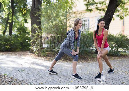 Beautiful Women Streching Outdoors