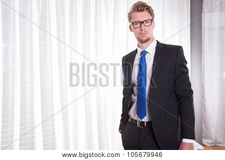 Portrait Smart Young Man In Suit And Tie