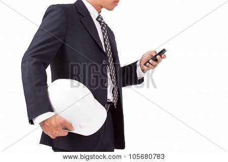 engineer holding white helmet with using smartphone isolated on white background