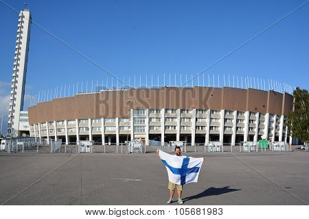 Man waving Finnish flag