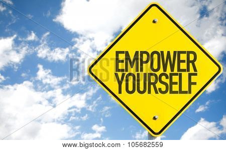 Empower Yourself sign with sky background
