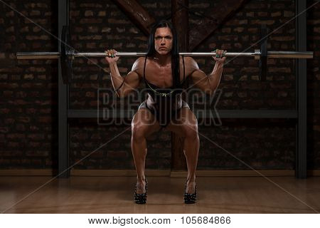 Young Woman In Underwear Exercising Barbell Squat