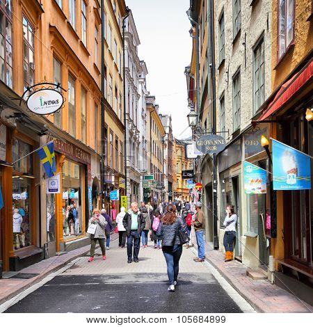 STOCKHOLM, SWEDEN - May 20, 2015: Tourists in central shopping street of Gamla Stan in Stockholm