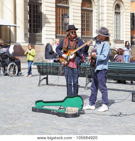 STOCKHOLM, SWEDEN - May 21, 2015: Unidentified strolling musicians play guitars on Stortorget square in Stockholm