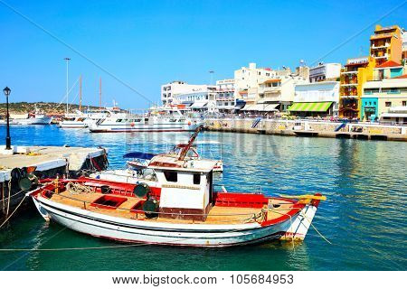 AGIOS NIKOLAOS, GREECE - JUNE 30, 2015: Picturesque port with boats and waterfront in harbor in Agios Nikolaos, Crete Island