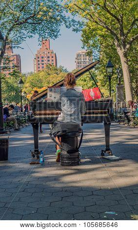 Playing Piano At Washington Square Garden New York
