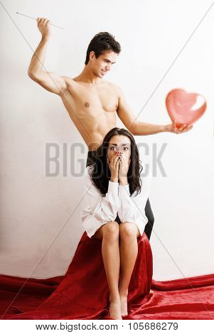 Man pierces the heart, she is going through. concept problematic relationship