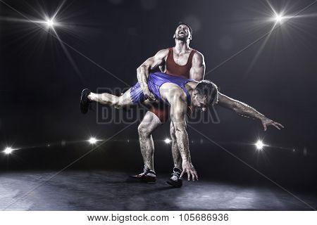 Freestyle wrestler throwing