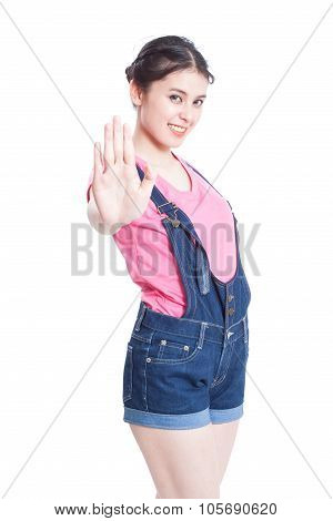 pretty young woman showing stop gesture. isolated on white background