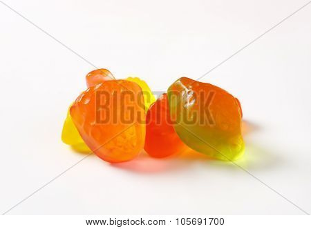 close up of fruit shaped gummy candies on white background