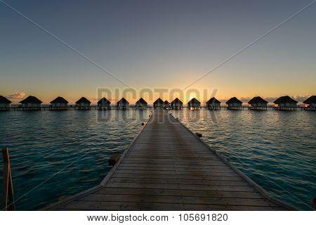 Sunset Moment At Luxury Resort, Wooden Walkway To Water Villa Bungalow, Maldives
