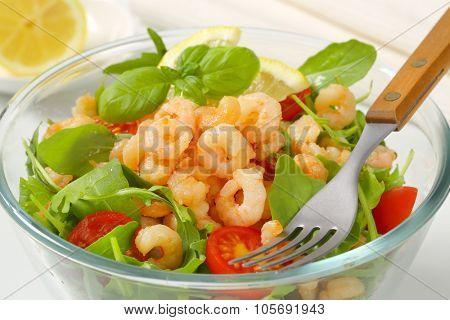 close up of fresh shrimp salad in glass bowl
