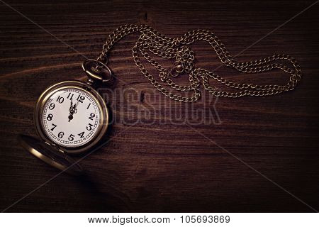 Old vintage watch on a wooden background