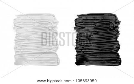 Strokes of black and white paint isolated on white background