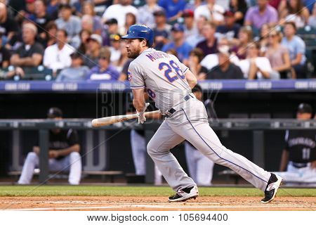 DENVER-AUG 21: New York Mets infielder Daniel Murphy swings a pitch during a game against the Colorado Rockies at Coors Field on August 21, 2015 in Denver, Colorado.