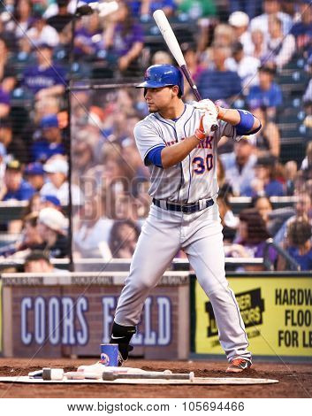 DENVER-AUG 21: New York Mets outfielder Michael Conforto waits on deck during a game against the Colorado Rockies at Coors Field on August 21, 2015 in Denver, Colorado.