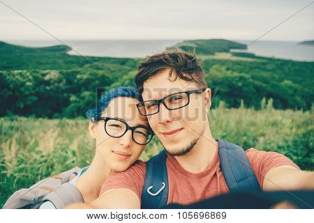 Young Couple Doing Selfie On Nature