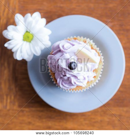 Delicious Cupcake With Blueberry Icing