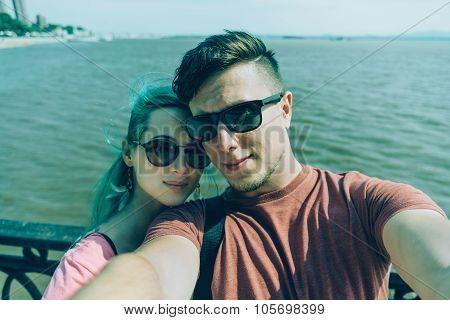 Traveler Couple Doing Self-portrait