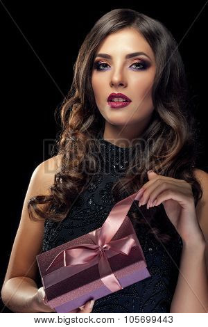 Woman With Gift Lookin Sensual To The Camera