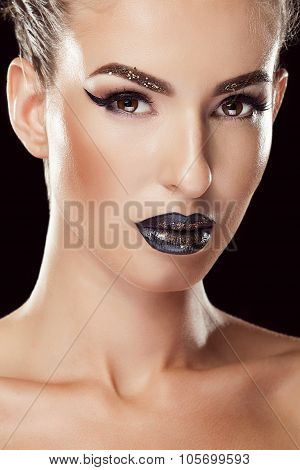 Woman With Black Make Up And Lips