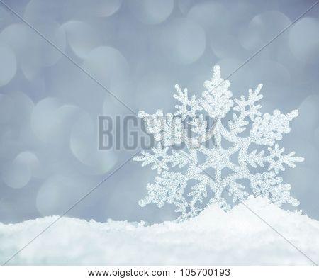 Snowflake on snow. Studio shot. Christmas