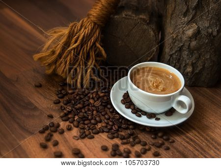 Cup of coffe with beans in earthy setting