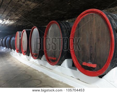 Old Traditional Wine Cellar With Big Wooden Barrels