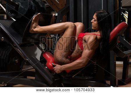 Young Woman In Underwear Using Leg Press