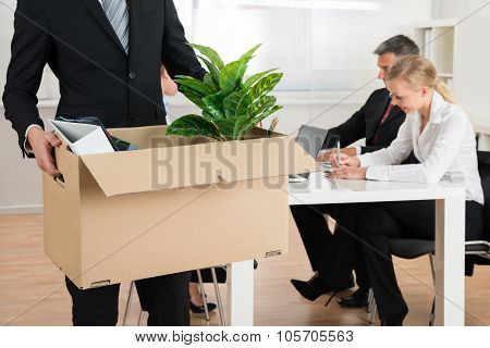 Businessman Carrying Personal Belongings