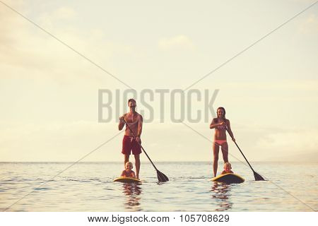 Family stand up paddling at sunrise, Summer fun outdoor lifestyle