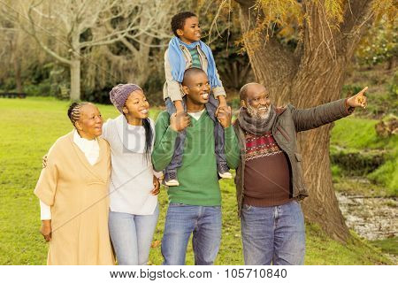 Extended family posing with warm clothes in parkland